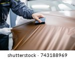 car wrapping specialist putting ... | Shutterstock . vector #743188969