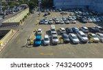 cars on an outdoor parking lot... | Shutterstock . vector #743240095