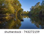 autumn color over water | Shutterstock . vector #743272159