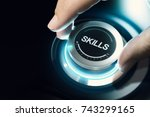 Small photo of Hand turning a skill test knob to the maximum position. Concept of professional or educational knowledge over black background. Composite image between a hand photography and a 3D background.