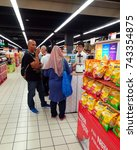 Small photo of KUALA LUMPUR, MALAYSIA on 23 July 2017 - a promoter man is giving free coffee sample tasting drink to a group of customer to promote their product in supermarket