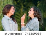 two teenage girls outdoors in... | Shutterstock . vector #743369089