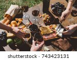 cropped shot of people drinking ... | Shutterstock . vector #743423131