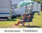 Elderly Couple Is Resting On...