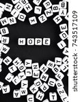 Small photo of Hope. Word on black background. A series of minimalism phrases and words.Vertical composition.