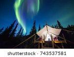 aurora borealis glowing green... | Shutterstock . vector #743537581