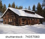 Snow Covered Log Cabin In A...