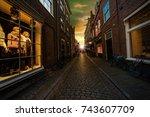 sunset at a quiet street of... | Shutterstock . vector #743607709