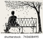 lonely man sits on the park... | Shutterstock .eps vector #743608495