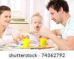 young  happy family in a room... | Shutterstock . vector #74362792