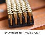 Shiny pistol ammunition on a...
