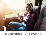 the woman on the passenger seat ... | Shutterstock . vector #743692444