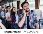the guy in the shirt is sitting ... | Shutterstock . vector #743693971