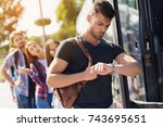 a group of tourists enters the... | Shutterstock . vector #743695651