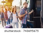 a group of tourists enters the... | Shutterstock . vector #743695675