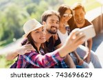 a group of tourists are sitting ... | Shutterstock . vector #743696629