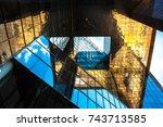 reflected light on buildings.   Shutterstock . vector #743713585