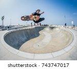 skateboarder flying at skate... | Shutterstock . vector #743747017