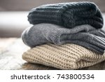 stack of cozy knitted sweaters... | Shutterstock . vector #743800534