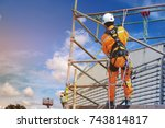 workers up high with safety... | Shutterstock . vector #743814817