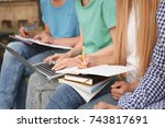 students studying outdoors ... | Shutterstock . vector #743817691