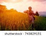 a man carrying a camera ... | Shutterstock . vector #743829151