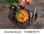 pasta with sausage in portioned ... | Shutterstock . vector #743869075