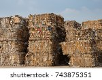 stack of paper waste before... | Shutterstock . vector #743875351