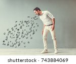handsome angry man is yelling... | Shutterstock . vector #743884069