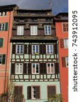 Small photo of Traditional and colorful Alsatian half-timbered houses in Petite France, Strasbourg, France.