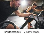 man and woman behind riding... | Shutterstock . vector #743914021
