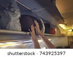 passengers putting luggage into ... | Shutterstock . vector #743925397