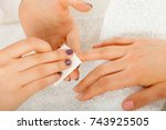 Small photo of Woman hand on towel, preparing gel hybrid manicure, using nail polish remover to remove dust and oil from nails. Beauty wellness spa treatment concept