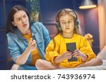 mother is scolding her child... | Shutterstock . vector #743936974