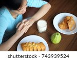 young woman eating breakfast... | Shutterstock . vector #743939524