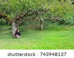the woman sit on the green... | Shutterstock . vector #743948137