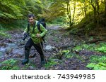 tourist with camera hiking on a ... | Shutterstock . vector #743949985