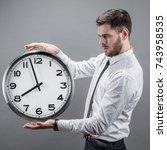 businessman with a clock | Shutterstock . vector #743958535