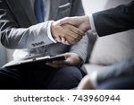 businessman shaking hands to... | Shutterstock . vector #743960944