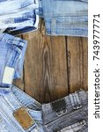 various colors jeans on a... | Shutterstock . vector #743977771