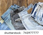 various colors jeans on a... | Shutterstock . vector #743977777