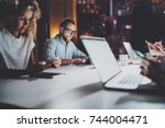 group of young coworkers work... | Shutterstock . vector #744004471