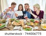 portrait of four happy people... | Shutterstock . vector #744006775