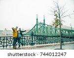 couple taking selfe near old...   Shutterstock . vector #744012247