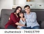 family relaxing indoors. family ... | Shutterstock . vector #744015799