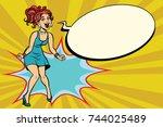 pop art retro woman shouts with ... | Shutterstock . vector #744025489