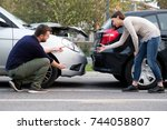 people arguing after a car... | Shutterstock . vector #744058807