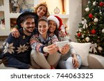 group of young cheerful people... | Shutterstock . vector #744063325