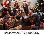group of young people toasting... | Shutterstock . vector #744063337