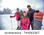 smiling family enjoying winter... | Shutterstock . vector #744063367